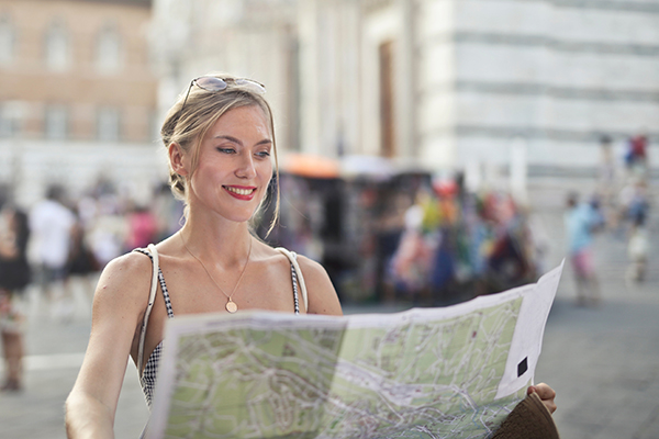 woman holding a guide map